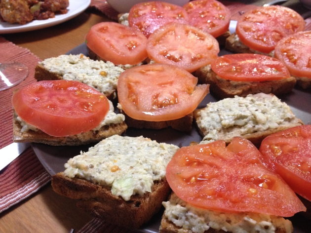 The eggplant salad on bread with tomato slices