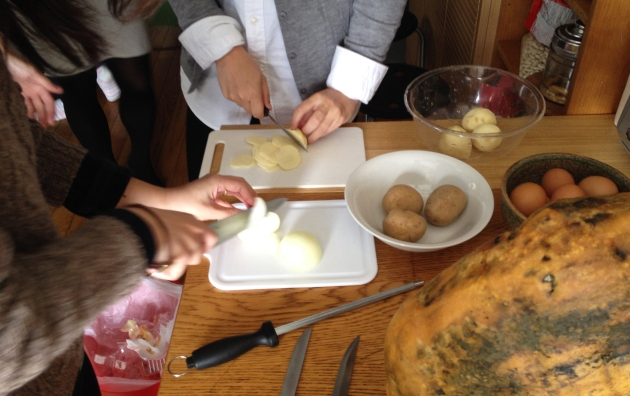 Helping chop potatoes